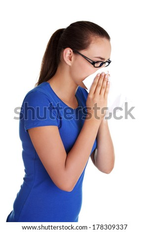 Young woman with tissue - sneezing  - stock photo