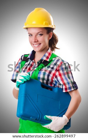 Young woman with toolkit on white - stock photo