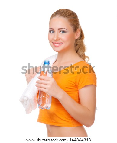 Young woman with towel and bottle with water isolated - stock photo
