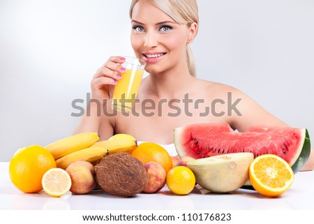young woman with tropical fruit front her, healthy lifestyle - stock photo