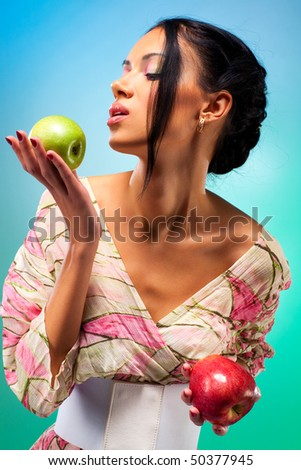 Young woman with two apples. Rich bright colors. - stock photo