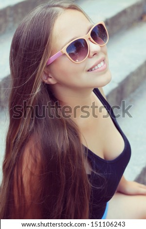 young woman with very long hair. fashion photo shoot - stock photo