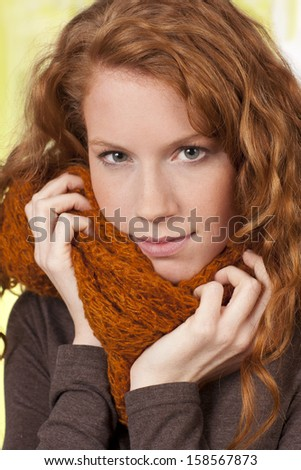 Young woman with warm shawl - stock photo