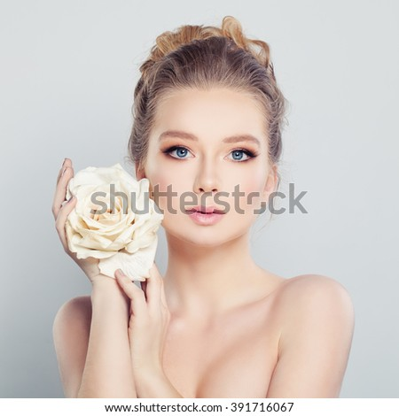Young Woman with White Rose. Spa Model - stock photo