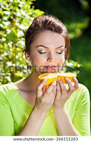 Young woman with with orange, healthy food concept, skin care and beauty, vitamins and minerals - stock photo