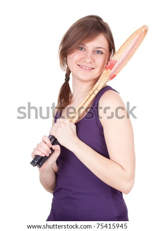 young woman with wooden badminton rackets - stock photo