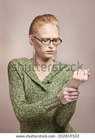 Young woman with wrist pain from carpal tunnel syndrome  - stock photo