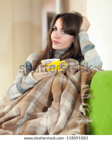 young woman with yellow cup in home - stock photo