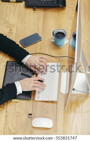 young woman working in a homely office with graphic tablet - stock photo