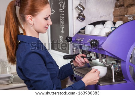 Young woman working in coffee shop  - stock photo