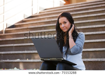 Young woman working on laptop - stock photo