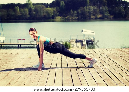 Young woman working out outdoors - stock photo