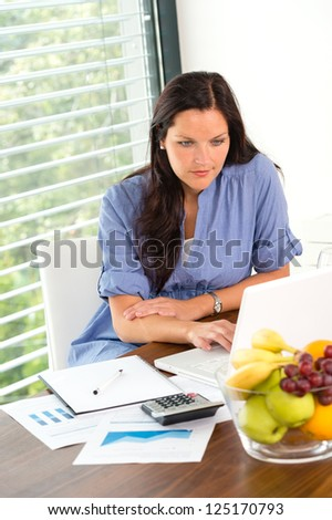 Young woman working using laptop studying office internet business - stock photo