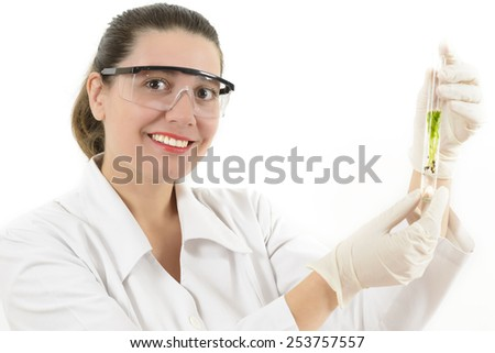 Young Woman working with plants in a lab - stock photo