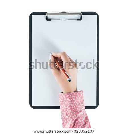 Young woman writing on a clipboard on a blank sheet against white background, hand close up - stock photo