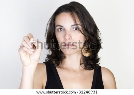Young woman writing on a virtual screen - stock photo