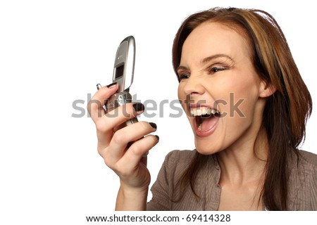 Young woman yelling at her cell phone - stock photo