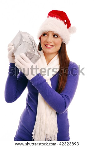 Young womanl trying to guess what christmas present she has - stock photo