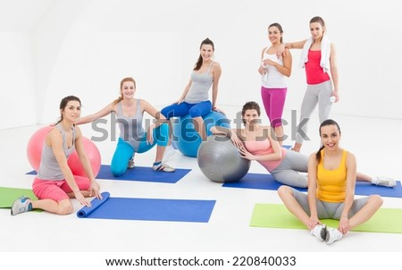 Young women after aerobics class in a studio. - stock photo