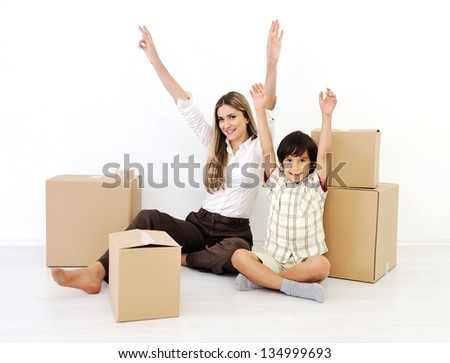 Young women and little boy with hands up - stock photo