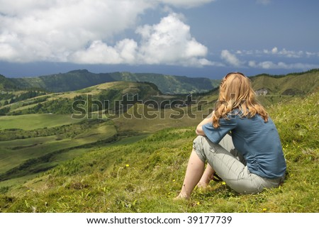 Young women at the summit of Pico das Eguas (Sao Miguel, Azores) - stock photo