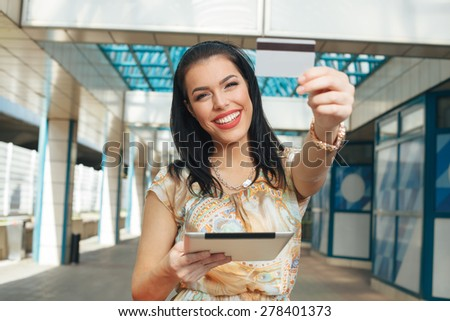Young women buying online through a digital tablet - stock photo