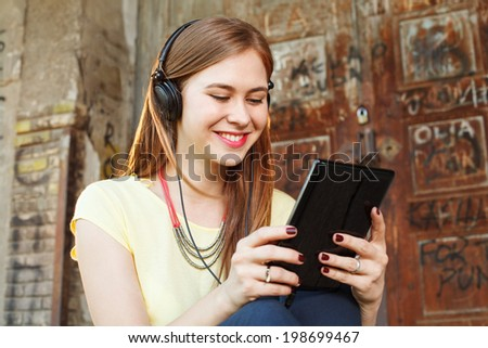 Young women chat via Tablet PC - stock photo
