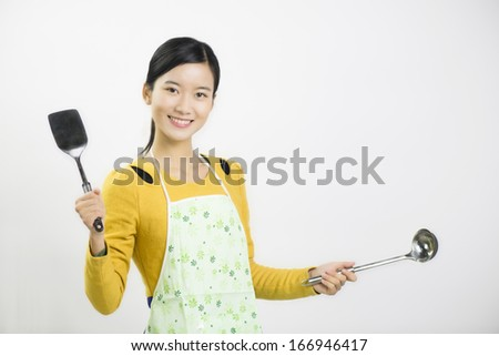 Young women cooking - stock photo