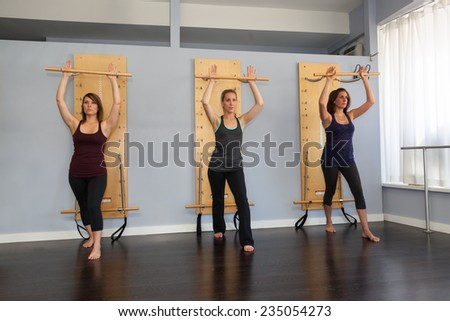 Young women doing pilates using springboard  - stock photo
