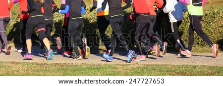 young women during the cross country race in public park - stock photo