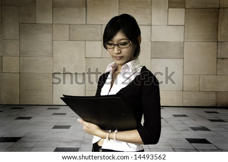 Young women holding a file, business/educational purpose. - stock photo