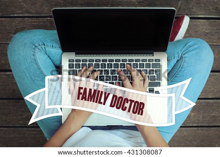 Young women holding laptop writen Family Doctor on it - stock photo