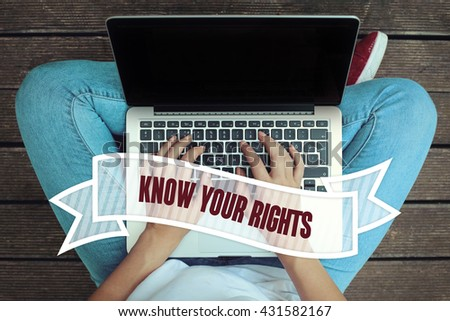 Young women holding laptop writen Know Your Rights on it - stock photo