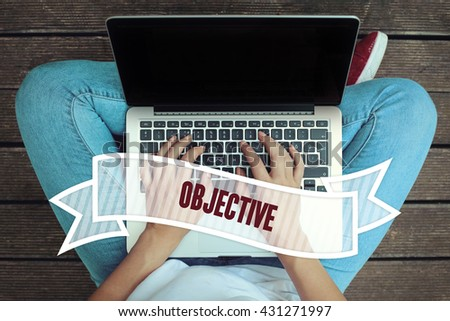 Young women holding laptop writen Objective on it - stock photo