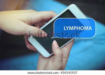 Young women holding mobile phone writen Lymphoma on it - stock photo