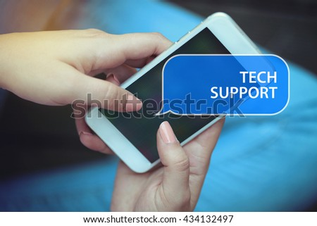 Young women holding mobile phone writen Tech Support on it - stock photo