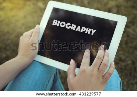Young women holding tablet writen Biography on it - stock photo