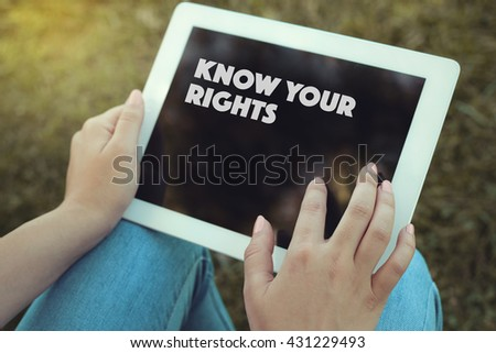 Young women holding tablet writen Know Your Rights on it - stock photo