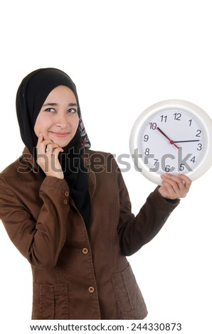 Young women holding the watch and feel doubtful  - stock photo