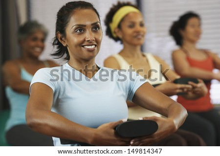 Young women in exercise class - stock photo