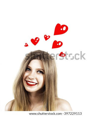 young women in love with rad hearts around the head.  isolated - stock photo
