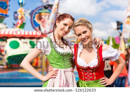 Young women in traditional Bavarian clothes - dirndl or tracht - on a festival or - stock photo
