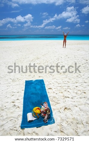 Young women is relaxing on the coral sandy beach - stock photo