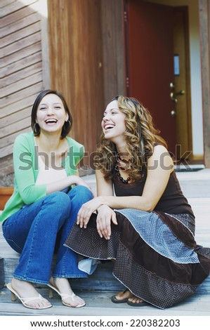 Young women laughing together - stock photo