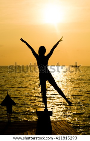 Young women on the beach and enjoy the sunset - stock photo
