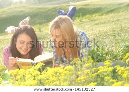 young women portrait in nature - stock photo