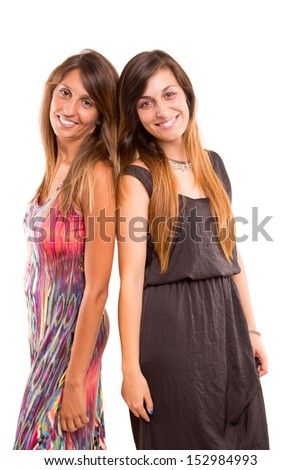 Young women posing isolated over a white background - stock photo