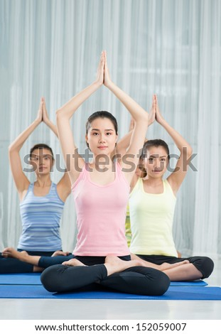 Young women practicing yoga on lotus position - stock photo