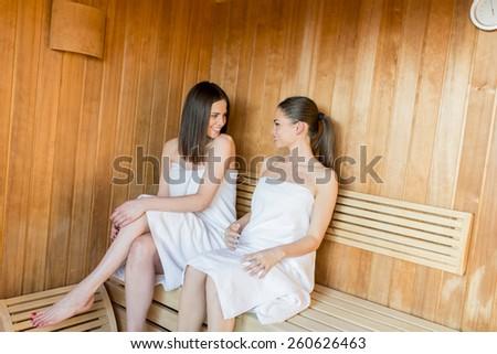 Young women relaxing in sauna - stock photo