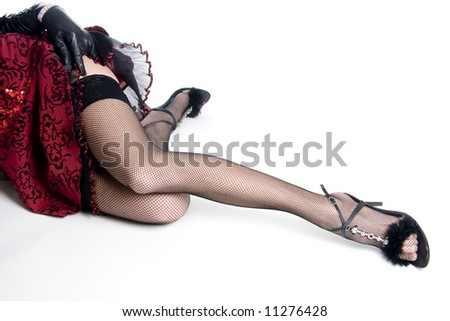 young women's sexy leg and hand in glove - stock photo